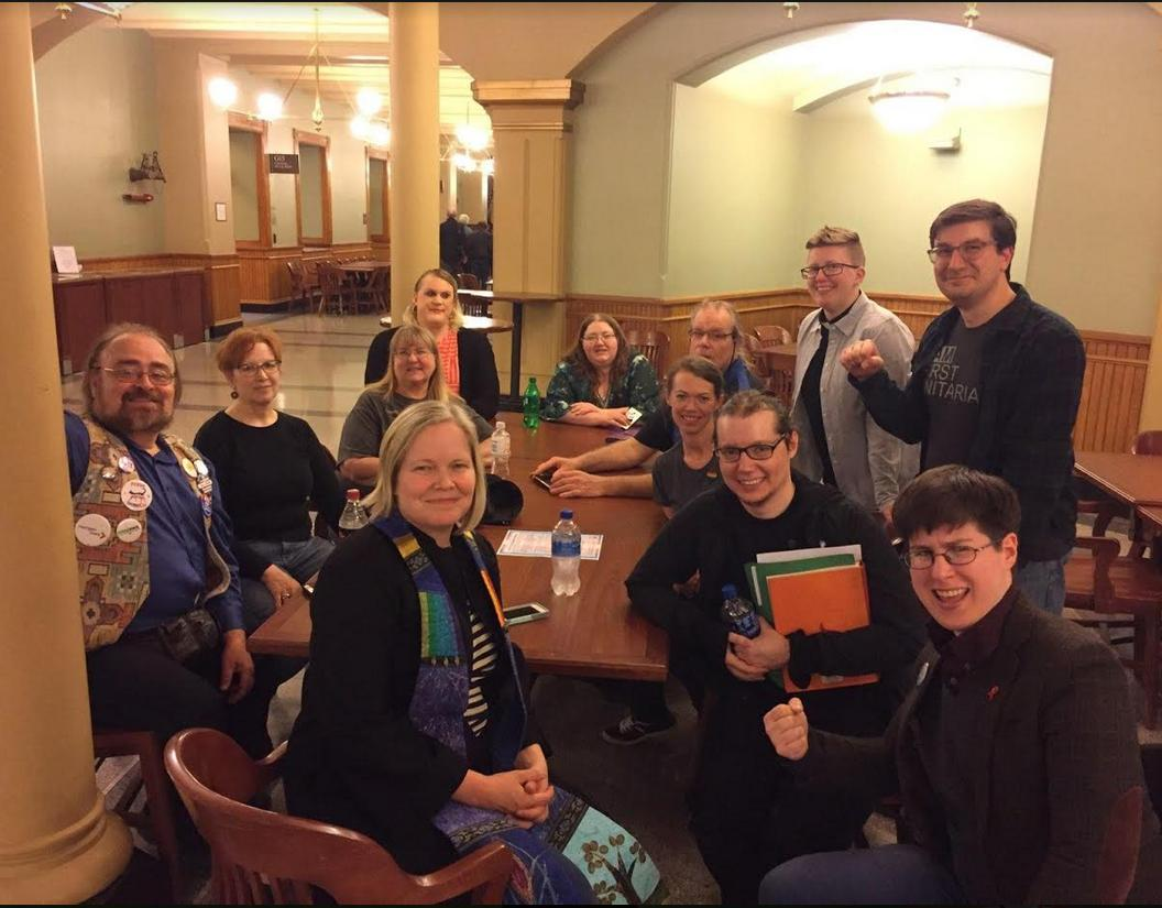 Members of the Trans Action Group pose at the Iowa Capitol with the First Unitarian Social Justice Minister and the Downtown Disciples Minister.